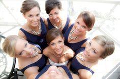 Fun bridesmaid photo op at the Hilton Pensacola Beach Gulf Front Hotel. photo by Carmen Jones Photography