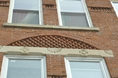 Fantastically unique brick-work above the windows of this Broadway building.