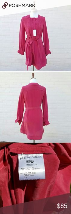 """See by Chloe Silk Magenta Dress New with tags Designer See by Chloe 100% silk Tie belt 3/4 button down Cuffed sleeves Oversized Pit to Pit approx 19"""" Length approx 35 1/2"""" See by Chloe Dresses"""