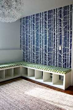 Turn an IKEA Expedit bookcase into an upholstered storage bench- add baskets for storage