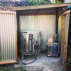 Metal shed lean-to is the best insurance and permit-friendly way to house the kiln. Local requirements here say detached utility shed w/o permit can be up to 120 sq ft. but not more than 8 ft high. Problem is breaker box being on wrong side of house.