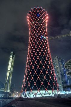 Amazing architecture design with beautiful lights - Aspire Tower in Doha, Qatar Unusual Buildings, Amazing Buildings, Modern Buildings, Doha, Futuristic Architecture, Amazing Architecture, Architecture Design, Facade Lighting, High Rise Building