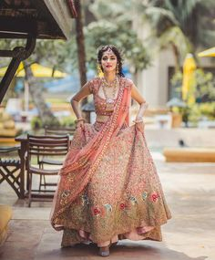 A heavily embellished peach lehenga by Shyamal and Bhumika for Jyoti at WeddingSutra Bridal Diaries