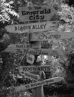 Wedding sign: points in direction of parking lot, ceremony, reception and other Hobbit themed places (the shire, bree, home of bilbo baggins, the lonely mountain) an a couple of random places (hogwarts, narnia, diagon ally, nockturn ally, malfoy manor, platform 9 3/4, aslans country, cair paravel)