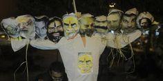 Jawaharlal Nehru University students burn effigy of Modi