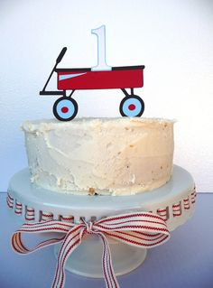 Adorable cake topper for a little red wagon party