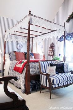 A Guest Bedroom in blue and white with red added just for the holidays. Gorgeous!
