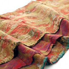 Love this. Red and lime green wool fibers are fused with a vintage silk sari to create a one-of-a-kind work of wearable art.