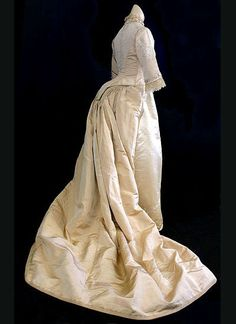 Hand-embroidered silk satin/faille bustle wedding dress, c.1881  This exceptional gown was the wedding dress of a Miss Custer in 1881