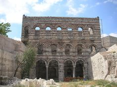 The Palace of the Tekfur Sarayı is a late 13th century Byzantine architecture in the north-western part of the old city of Constantinople. In the picture, the Place is designed as a large three-story building that has ground floor that was developed into an arcade with four arches, while the first floor structured with five large windows. The remaining walls are elaborately decorated in geometric designs using red brick and white marble typical of the late Byzantine period.