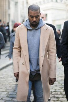 Kanye, camel coat, hoodie, light faded denim jeans