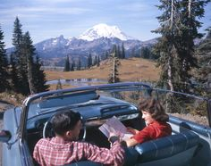 ROAD TRIP 1961 STYLE: Here is a couple poised to take an epic road trip into the American northwest, in our favorite year 1961! They came prepared. They've got their map and a spiffy convertible! And look at that scenery. They picked a perfect region for their outing. The American northwest - and its counterpart on the other side of the border, the Canadian west - offers some of the most breathtaking scenic beauty on earth.