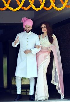 Kareena Kapoor posing with Saif Ali Khan at Soha Ali Khan & Kunal Khemu wedding.