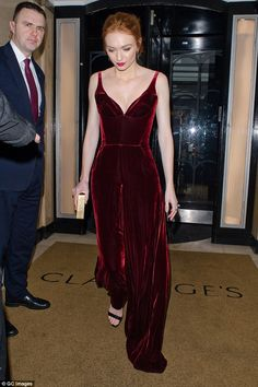 Taking the plunge: Eleanor Tomlinson sported a plunging crimson velvet jumpsuit and strappy black sandals as she attended the Radio Times Covers party at Claridges on Tuesday