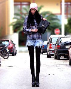 plaid shirt, denim cutoffs, black tights, black shoes