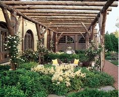 Rustic but oh so sophisticated pergola and terrace. Designed by Chicago landscape architecture firm, Jacobs/Ryan Associates. Photo by Tony Soluri. Furniture by Brown Jordan.
