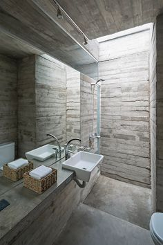 Board-formed concrete also features in the bathroom of House by Luciano Kruk . Board-formed concrete also features in the bathroom of House by Luciano Kruk Arquitectos in Costa Esmeralda, Argentina Interior Design Examples, Interior Design Inspiration, Concrete Architecture, Interior Architecture, Futuristic Architecture, New Yorker Loft, Board Formed Concrete, Concrete Interiors, Beton Design