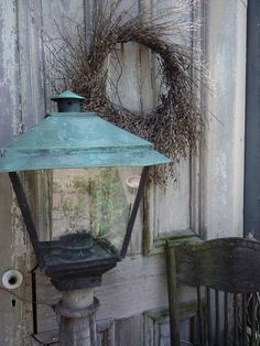 old lantern with old door and wreath