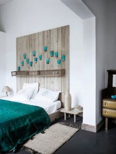 diy wood headboard and wonderful teal color attach mason jars in stained colours and add tea candles or white Christmas lights!!
