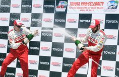 (Will Lester/Staff Photographer)  Toyota Pro/Celebrity race winners Adam Carolla (left) and Rutledge Wood celebrate in Victory Lane following the Toyota Pro/Celebrity Race Saturday morning April 20, 2013 at the 39th annual Toyota Grand Prix of Long Beach.