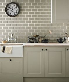 Kitchen wall tiles are perfect to add character to your cooking space. Whether it's a feature splashback or a simple border, there is something for everyone in our collection of kitchen wall tiles. Sage Kitchen, New Kitchen, Olive Green Kitchen, Kitchen Wall Tiles, Kitchen Backsplash, Kitchen Cabinets, Metro Tiles Kitchen, Cream Kitchen Tiles, Country Kitchen Tiles