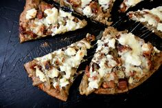 "caramelized onion, bacon and goat cheese pizza. The ""sauce"" for this pizza is actually not a sauce, but a sweet, gooey result of onions simmering in bacon grease with a touch of honey, paired perfectly with salty bacon and rich decadent goat cheese."