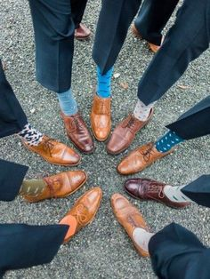 Splash some color on your guys' feet with some creative socks. Have the groom hook up his favorite guys with a cool pair before the wedding. It makes for a great photo! | 11 Groomsman Ideas That Stand Out