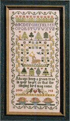 "From designer Moira Blackburn is this cross stitch pattern titled ""Green Tree"".  The saying reads ""always keep a green tree in your heart so that the singing bird may come"".  The cross stitch pattern is stitched with DMC threads."