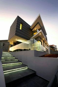 Dusk at the Radial House, designed by Tsikkinis Architecture Studio. The angles on the house are sharp and modern. We love the lights the illuminate the stairs by night. Contemporary Stairs, Contemporary Architecture, Architecture Design, Architecture Artists, Architecture Today, Contemporary Homes, Dream Home Design, Modern House Design, Beautiful Modern Homes