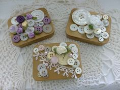 Inspired by some other PInterest projects, I created these button boxes from mint tins, sprayed gold, and buttons glued on with rose accent. Craft Nut in Buttonmania.