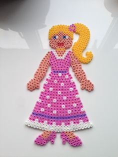 Hama Girl in a pink dress, high heels and hair is tied in a side pony.