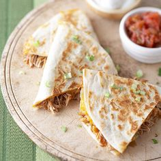 Dip quesadilla wedges into salsa and green onion-topped sour cream. Or top the quesadillas and eat them with a knife and fork.