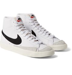 Nike's 'Blazer Mid sneakers stay true to the decades-old design - you can't go wrong with a classic. They're made from smooth white leather with black suede Swooshes and set on cushioned rubber soles. Casual Sneakers, Leather Sneakers, High Top Sneakers, Buy Shoes, Me Too Shoes, Nike Shoes, Tenis Vans, Dream Shoes, Toddler Shoes