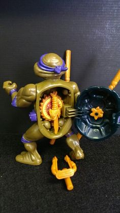 1990 Teenage Mutant Ninja Turtles action figure Donatello - tmmt by Playmates- with storage shell for accessories, complete.