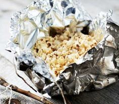 Campfire Popcorn Satchels-  2 Tbs popcorn and 2 Tbs oil on an 18-inch square of heavy-duty aluminum foil. Seal the edges to form a loose pouch, leaving room for the kernels to pop. Tie a corner of the pouch to a stick with a piece of string. Shake over a fire until popped
