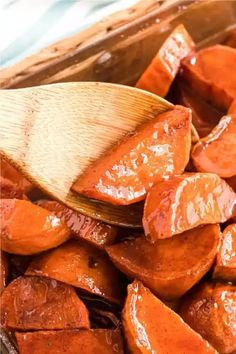 These baked candied yams are a Thanksgiving and holiday favorite. Glazed in a deliciously gooey butter and brown sugar sauce that's packed full of warm spices like cinnamon and nutmeg. This ultimate candied yam recipe is an impressive side dish and is a southern staple on a Thanksgiving table. These yams are quick to make. Most of the work for this delicious recipe happens in the oven. Do the slicing prep ahead of time to make it even easier to make when it's time for your meal.