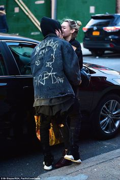 Kiss, kiss: Jaden Smith looks as loved-up as ever with his girlfriend Sarah Snyder as they...