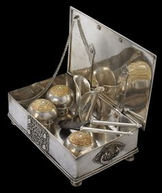 Batavia, Dutch East Indies, early 19th century silver betel box and set, comprising the box, a pair of betel shears (kacip), a leaf holder, and three spherical, lidded betel containers with gilded repoussed silver tops.