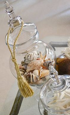shell-filled cloche with tassle -- link goes to blog w stunning pix. ~~~