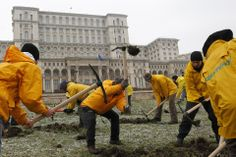 GROUNDBREAKING: Greenpeace activists dug into the yard of Romania's Parliament in Bucharest on Monday to protest against a Canadian company'...