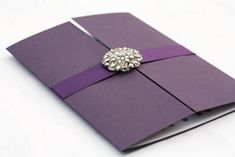 Daisy wedding invitations in Aubergine with crystals