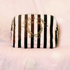 Forever 21 Makeup Bag Adorable black and white striped Forever 21 Makeup Bag with gold print. Used but in decent condition.  ⭐Bundle this bag with 1 or more other items from my closet to save even more with my bundle discount! Get 15% of your purchase of 2 or more items from my closet!⭐  ✅ Price is negotiable. Make me a reasonable offer!  No trades.  Fast same day shipping! Forever 21 Bags Cosmetic Bags & Cases