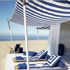 A canopy of striped blue and white fabric makes the perfect, lounge-worthy beach cabana. From Ralph Lauren Home Home Living, Coastal Living, Outdoor Spaces, Outdoor Living, Outdoor Decor, Outdoor Lounge, Coastal Style, Coastal Decor, Beach House Decor