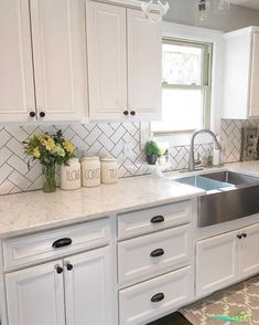 """Robin Norton's Instagram profile post: """"It's been a lazy Saturday morning around here. The kids and I have been lounging around and it's been great! . How does everyone make their…"""" White kitchen, kitchen decor, subway tile, herringbone subway tile, farmhouse sink, stainless steel farmhouse sink, Rae Dunn, white cabinets, white backsplash, modern farmhouse, farmhouse Style, farmhouse decor, black hardware   See Instagram photos and videos from Robin Norton (@rocknrob)<br>"""
