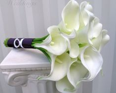 This creamy white calla lily bridesmaid wedding bouquet set is made from our real touch flower collection. These callas are so soft to touch & look very real. There are 14 cream mini calla lilies in this bouquet. Each calla bloom measures 2 Wedding Bridesmaid Flowers, Lily Bouquet Wedding, Bridesmaid Bouquet White, Calla Lily Bouquet, White Wedding Bouquets, Calla Lilies, Flower Bouquets, White Plum, Plum Purple