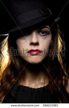 http://thumb101.shutterstock.com/display_pic_with_logo/797713/288213383/stock-photo-woman-with-smeared-make-up-by-crying-tears-noir-style-she-is-wearing-a-hat-and-on-a-black-288213383.jpg