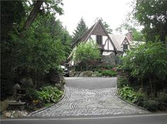 Beautiful decorative accents on this driveway. Created by Sitescapes Landscape Design in Stony Brook, NY. For more driveway photos, visit http://www.landscapingnetwork.com/driveways/