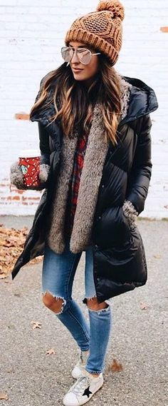 #winter #fashion / Brown Beanie / Black Puff Jacket / Grey Faux Fur Vest / Destroyed Skinny Jeans / White Sneakers