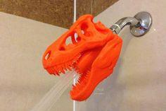 Molde de cabeça de dinossauro laranja como ducha de banheiro. Que tal uma cabeça de dinossauro como ducha de banheiro?