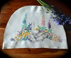 Check out this item in my Etsy shop https://www.etsy.com/uk/listing/294015543/hand-embroidered-cottage-garden-vintage